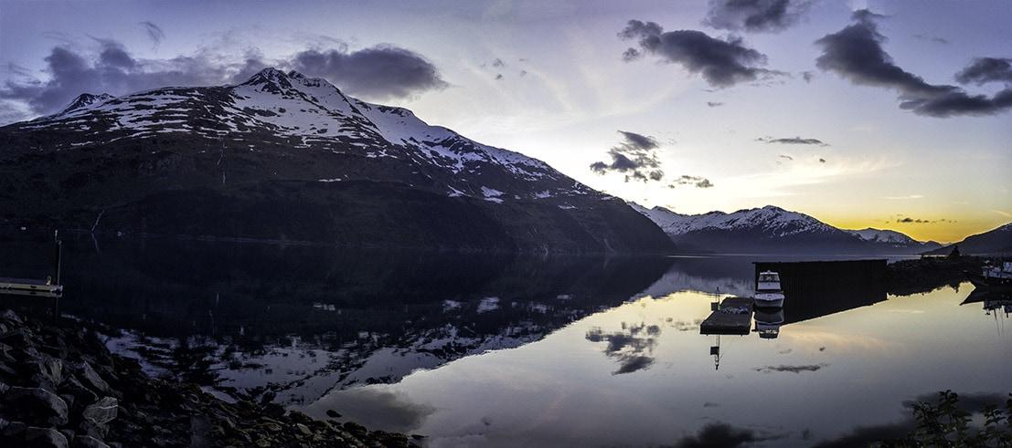 Sunrise in Whittier Alaska reflecting off the water
